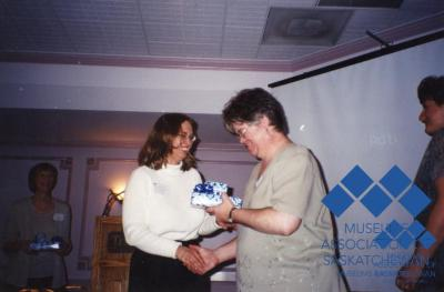 Joan Kanigan-Fairen presenting Wendy Fitch with 15 years of service